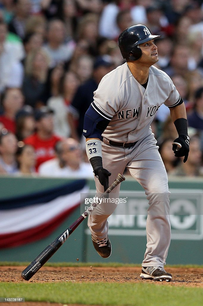 Nick Swisher #33 of the New York Yankees watches his hit against the Boston Red Sox on April 21, 2012 at Fenway Park in Boston, Massachusetts.