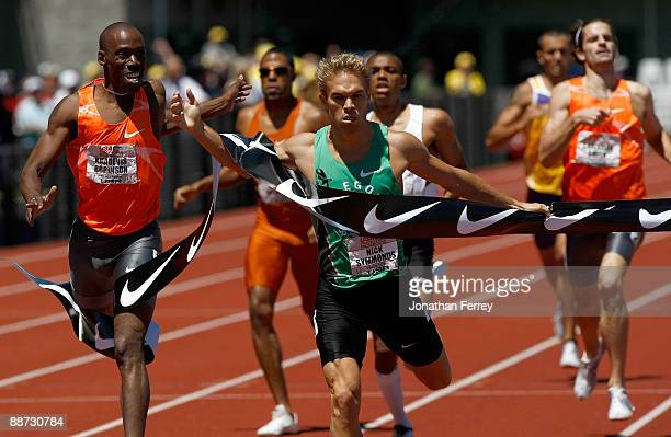 Nick Symmonds crosses the finish line to win the 800m ahead of Khadevis Robinson during day 4 of the USA Track and Field National Championships on...