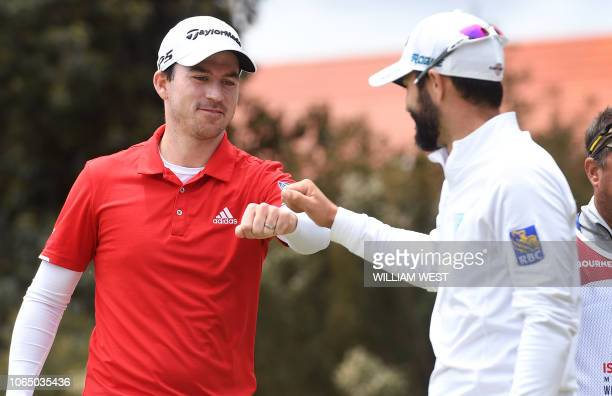 Nick Taylor and Adam Hadwin of Canada bump fists on the final day of the World Cup of Golf at the Metropolitan Golf Club in Melbourne on November 25...