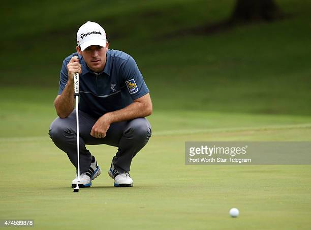 Nick Taylor lines up a putt on the 5th green during the third round of the Crowne Plaza Invitational at the Colonial in Fort Worth, Texas, on...