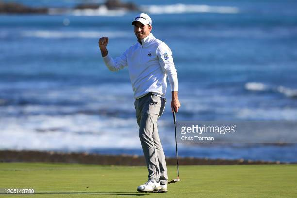 Nick Taylor of Canada celebrates on the 18th green after winning the ATT Pebble Beach ProAm at Pebble Beach Golf Links on February 09 2020 in Pebble...
