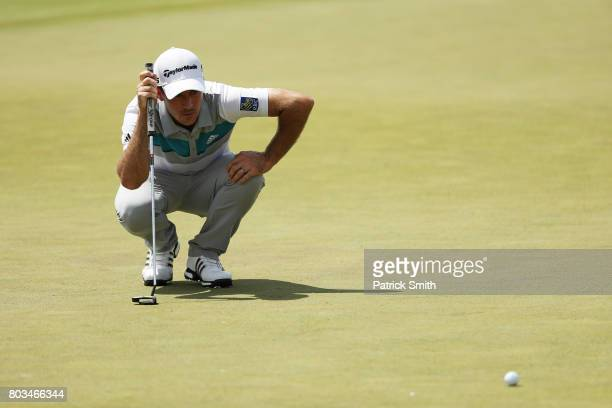Nick Taylor of Canada lines up a putt on the 17th green during the first round of the Quicken Loans National on June 29 2017 TPC Potomac in Potomac...