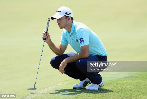 Nick Taylor of Canada lines up a putt on the 18th green during the first round of THE PLAYERS Championship on the Stadium Course at TPC Sawgrass on...