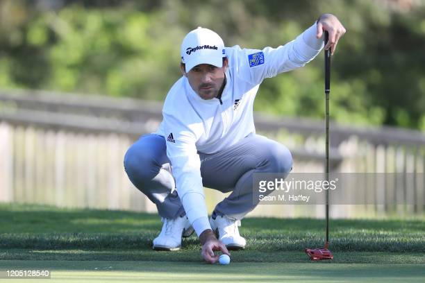 Nick Taylor of Canada looks over a putt on the 16th green during the final round of the ATT Pebble Beach ProAm at Pebble Beach Golf Links on February...