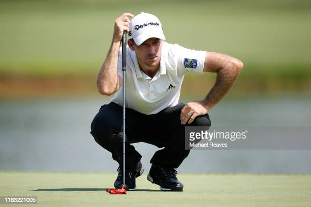 Nick Taylor of Canada looks over a putt on the 18th green during the third round of the Barbasol Championship at Keene Trace Golf Club on July 20...