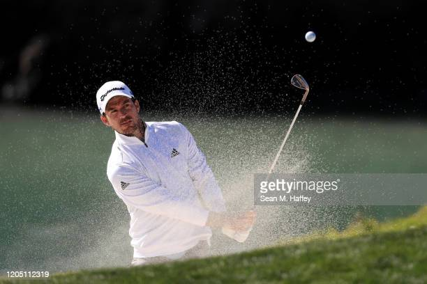 Nick Taylor of Canada plays a shot from a bunker on the eighth hole during the final round of the ATT Pebble Beach ProAm at Pebble Beach Golf Links...