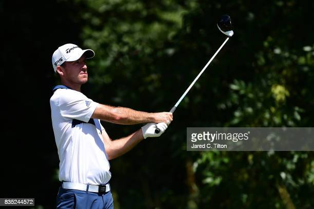 Nick Taylor of Canada plays his tee shot on the 13th hole during the second round of the Wyndham Championship at Sedgefield Country Club on August 18...