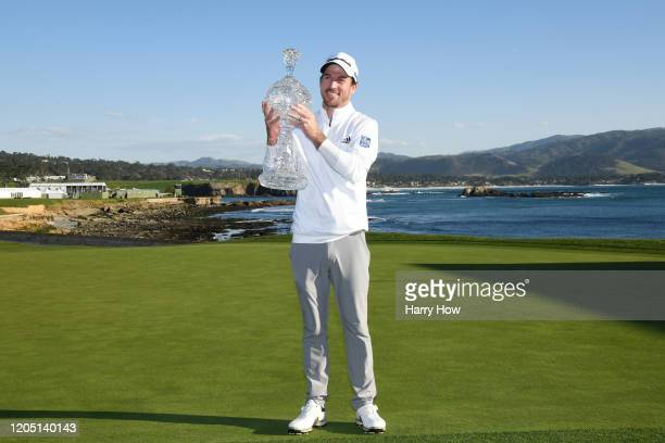 Nick Taylor of Canada poses with the trophy after winning the ATT Pebble Beach ProAm at Pebble Beach Golf Links on February 09 2020 in Pebble Beach...