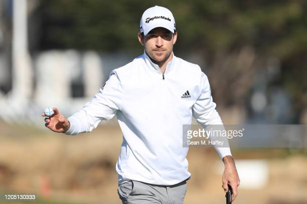 Nick Taylor of Canada reacts after a putt on the 17th green during the final round of the ATT Pebble Beach ProAm at Pebble Beach Golf Links on...