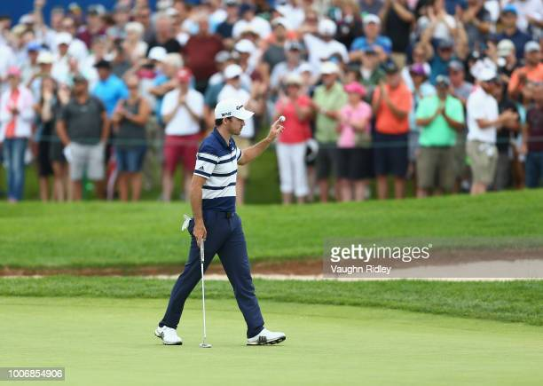 Nick Taylor of Canada reacts to his eagle putt on the 18th green during the third round at the RBC Canadian Open at Glen Abbey Golf Club on July 28...