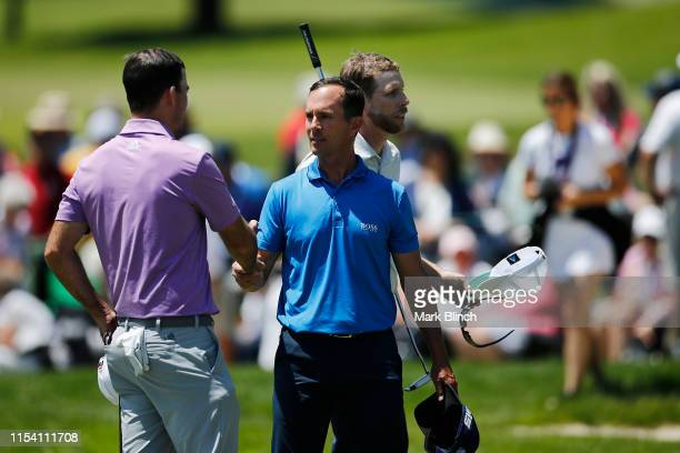 Nick Taylor of Canada shakes hands with Mike Weir of Canada and David Hearn of Canada after their round in the first round of the RBC Canadian Open...