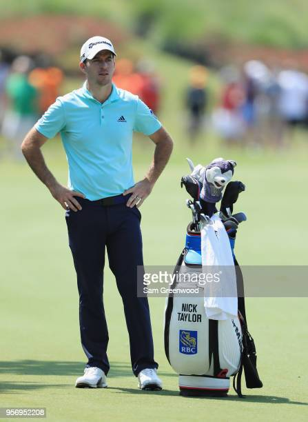 Nick Taylor of Canada stands with his bag on the 18th hole during the first round of THE PLAYERS Championship on the Stadium Course at TPC Sawgrass...
