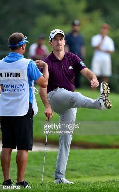 Nick Taylor of Canada stretches before his shot during round one of the RBC Canadian Open at Glen Abbey Golf Club on July 27 2017 in Oakville Canada