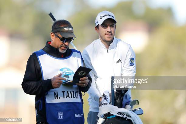 Nick Taylor of Canada talks with his caddie before playing his shot from the second tee during the final round of the ATT Pebble Beach ProAm at...