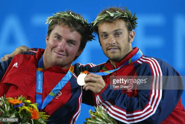 Nick Taylor of the USA celebrates with his partner David Wagner after winning the final of the Men's Quad Gold medal match during the Athens 2004...