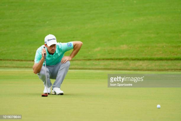 Nick Taylor studies his line before his putt for birdie during the third round of the Wyndham Championship on August 18 at Sedgefield Country Club in...