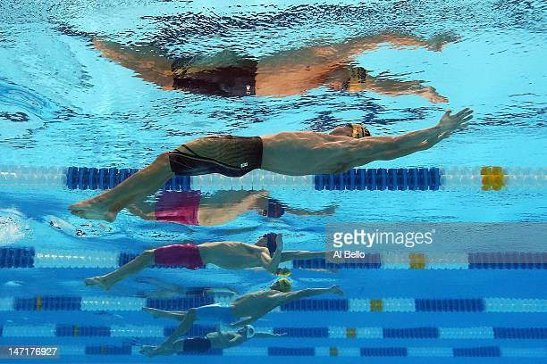 Nick Thoman and Ryan Murphy compete in the sfirst semifinal heat of the Men's 100 m Backstroke during Day Two of the 2012 US Olympic Swimming Team...