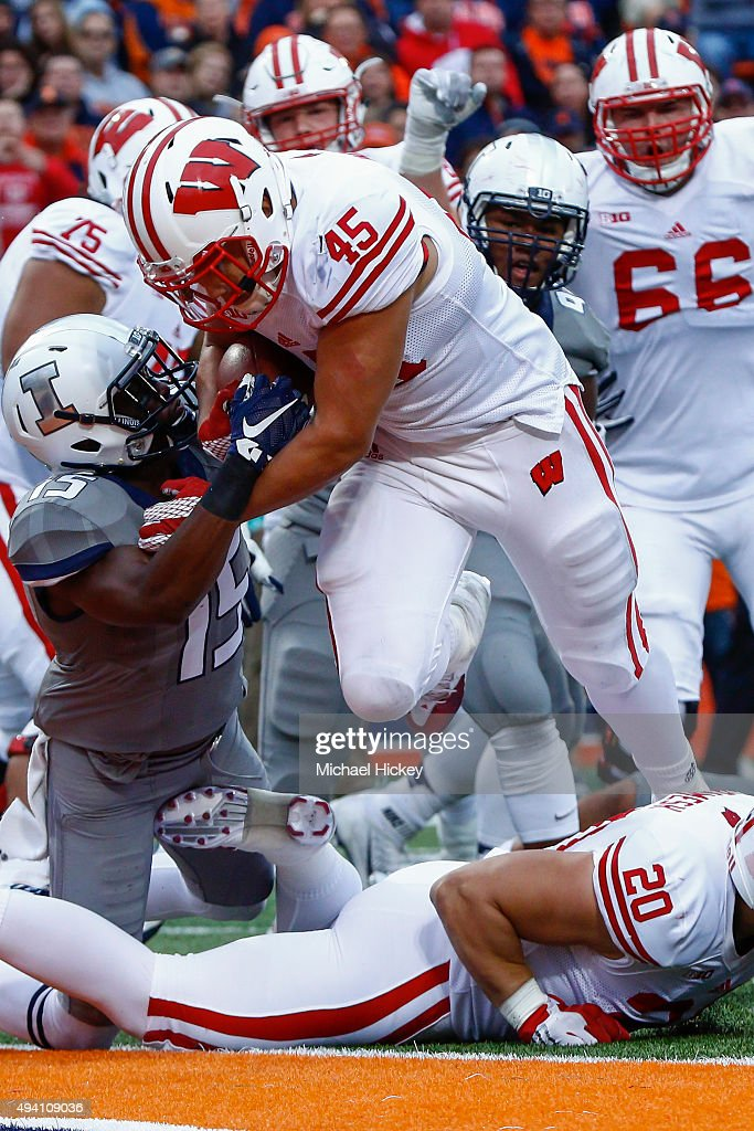 Nick Thomas #45 of the Wisconsin Badgers runs the ball into the end zone for a touchdown as Jevaris Little #15 of the Illinois Fighting Illini tries to make the stop at Memorial Stadium on October 24, 2015 in Champaign, Illinois. Wisconsin defeated Illinois 24-13.