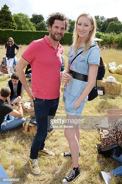 Nick Thorp and Jade Parfitt attend The Mulberry Wilderness Picnic with Cara Delevingne during Wilderness 2014 at Cornbury Park on August 9 2014 in...