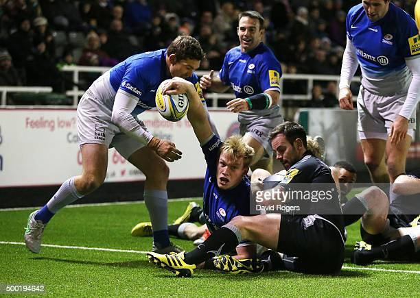 Nick Tompkins of Saracens celebrates after scoring a try during the Aviva Premiership match between Newcastle Falcons and Saracens at Kingston Park...