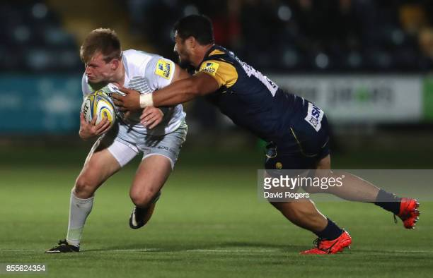 Nick Tompkins of Saracens is tackled by Alafoti Faosiliva during the Aviva Premiership match between Worcester Warriors and Saracens at Sixways...