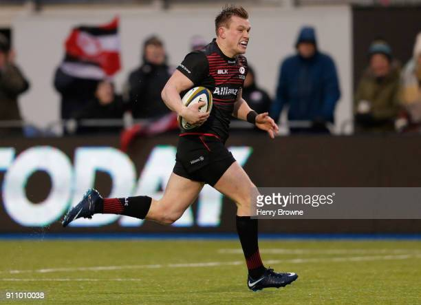 Nick Tompkins of Saracens runs in to score a try during the AngloWelsh Cup match between Saracens and Dragons at Allianz Park on January 27 2018 in...