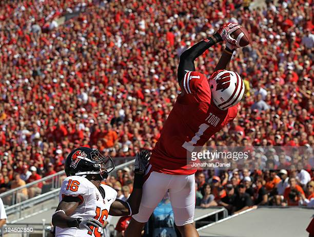 Nick Toon of the Wisconsin Badgers grabs a touchdown pass over Rashaad Reynolds of the Oregon State Beavers at Camp Randall Stadium on September 10...