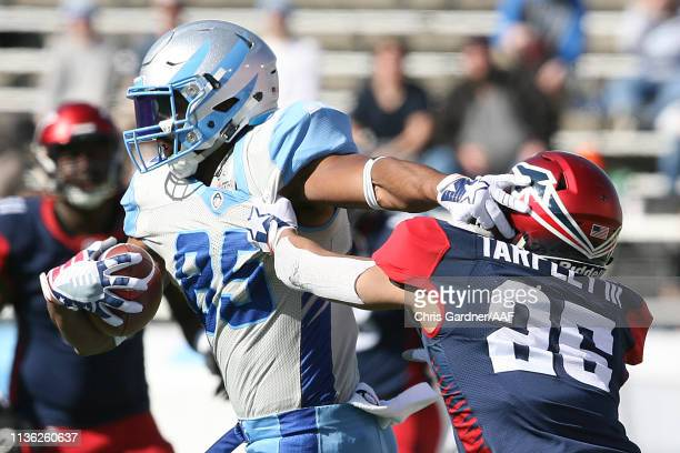 Nick Truesdell of the Salt Lake Stallions runs the ball against Arnold Tarpley III of the Memphis Express during the third quarter at Rice Eccles...