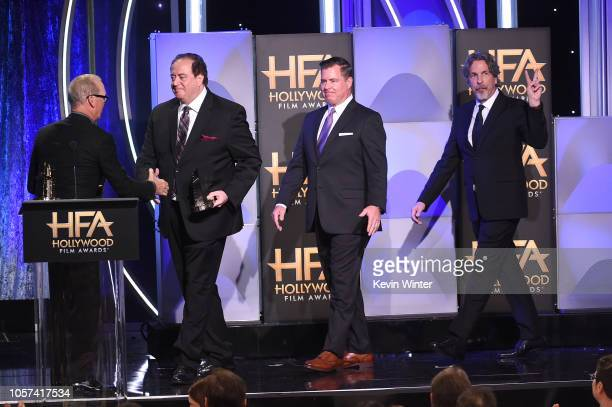 Nick Vallelonga Brian Hayes Currie and Peter Farrelly accept the Hollywood Screenwriter Award from Michael Keaton onstage during the 22nd Annual...