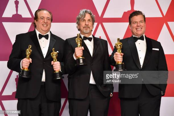 Nick Vallelonga Peter Farrelly and Brian Currie poses with the Best Picture and Best Original Screenplay award for Green Book in the press room...