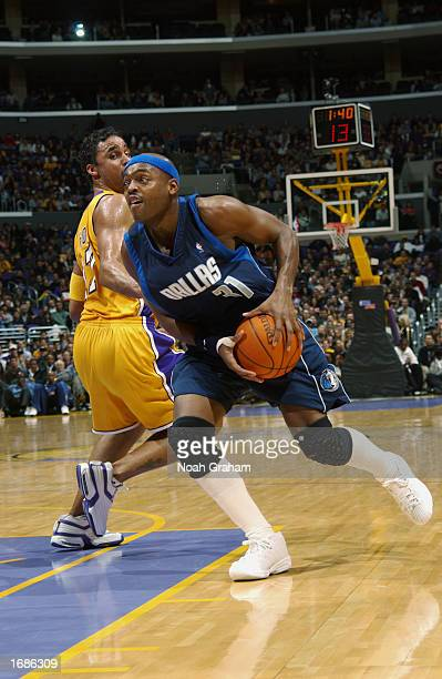 Nick Van Exel of the Dallas Mavericks drives to the basket around Rick Fox of the Los Angeles Lakers during the NBA game at Staples Center on...