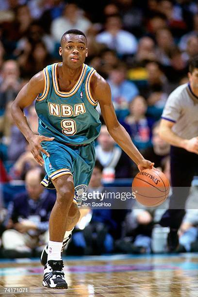 Nick Van Exel of the Eastern Conference dribbles upcourt against the Western Conference during the 1994 Shick Rookie Game played February 11 1994 at...