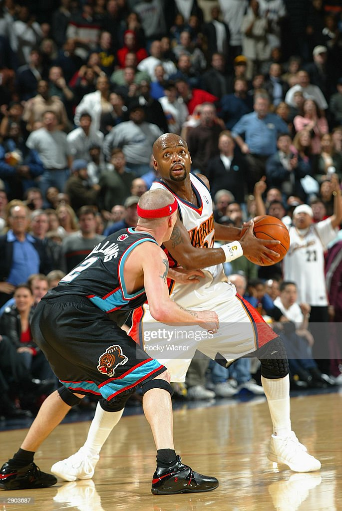 Nick Van Exel #37 of the Golden State Warriors is defended by Jason Williams #2 of the Memphis Grizzlies during the game at the Arena in Oakland on January 12, 2004 in Oakland, California. The Grizzlies won in double overtime 115-113.