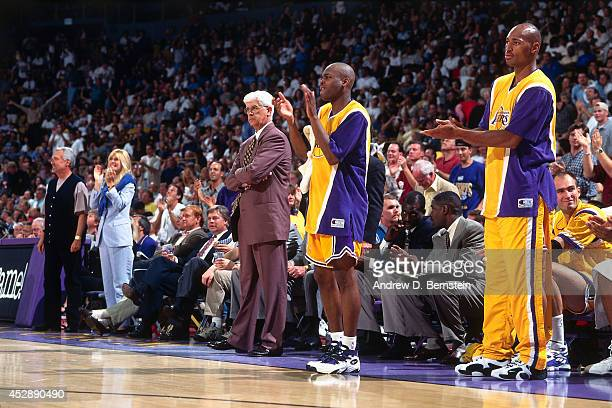 Nick Van Exel of the Los Angeles Lakers applauds during a game played circa 1996 at the Great Western Forum in Inglewood California NOTE TO USER User...