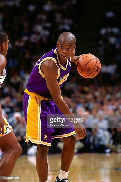Nick Van Exel of the Los Angeles Lakers dribbles circa 1997 at the Oakland Coliseum in Oakland California NOTE TO USER User expressly acknowledges...