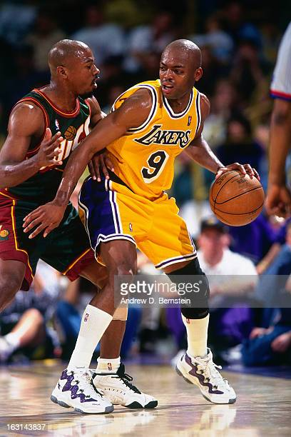Nick Van Exel of the Los Angeles Lakers dribbles the ball against the Seattle Supersonics in Game Four of the Western Conference Semifinals as part...