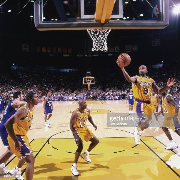Nick Van Exel of the Los Angeles Lakers goes to the basket against the Charlotte Hornets circa 1997 at the Great Western Forum in Inglewood...