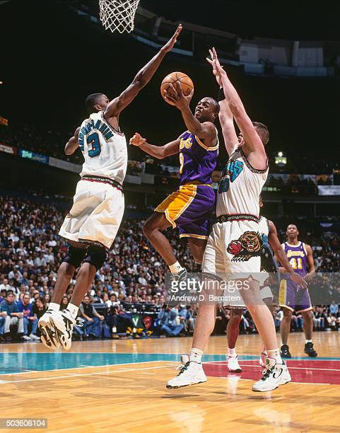 Nick Van Exel of the Los Angeles Lakers shoots against Shareef AbdurRahim of the Vancouver Grizzlies on January 5 1997 at the General Motors Palace...