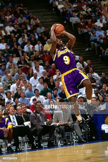 Nick Van Exel of the Los Angeles Lakers shoots circa 1997 at the Oakland Coliseum in Oakland California NOTE TO USER User expressly acknowledges and...