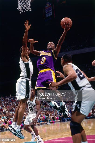 Nick Van Exel of the Los Angeles shoots during Game Two of the Second Round of the 1995 NBA Playoffs played on May 16 1995 at the Alamo Dome in San...