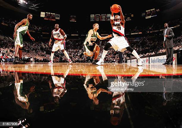 Nick Van Exel of the Portland Trail Blazers grabs the ball as Luke Ridnour of the Seattle SuperSonics guards him on November 30 2004 at the Rose...