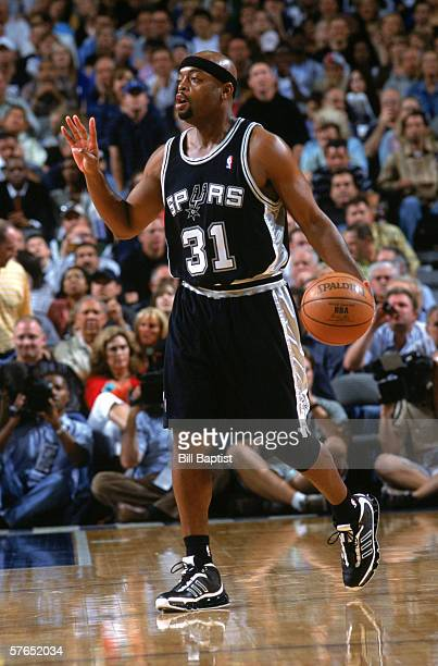 Nick Van Exel of the San Antonio Spurs calls a play as he moves the ball up court in game four of the Western Conference Semifinals against the...