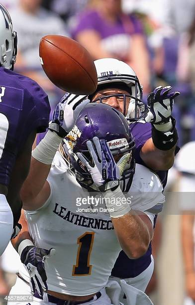 Nick VanHoose of the Northwestern Wildcats breaks up a pass intended for Joey Borselino of the Western Illinois Leathernecks on September 20 2014 at...