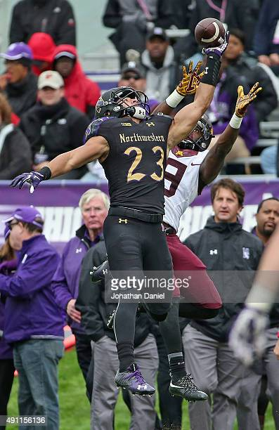Nick VanHoose of the Northwestern Wildcats breaks up a pass intended for Eric Carter of the Minnesota Golden Gophers at Ryan Field on October 3, 2015...
