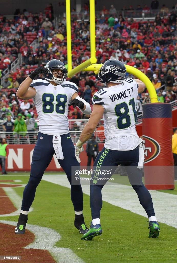 Nick Vannett #81 and Jimmy Graham #88 of the Seattle Seahawks celebrates after Vannett caught a touchdown pass against the San Francisco 49ers during their NFL football game at Levi's Stadium on November 26, 2017 in Santa Clara, California.