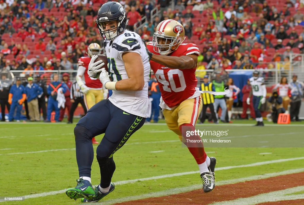 Nick Vannett #81 of the Seattle Seahawks catches a touchdown pass over Antone Exum #40 of the San Francisco 49ers during their NFL football at Levi's Stadium on November 26, 2017 in Santa Clara, California.