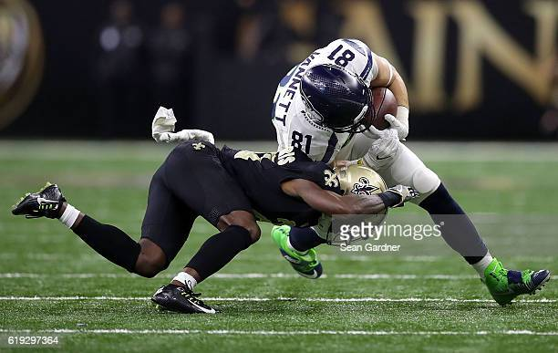 Nick Vannett of the Seattle Seahawks is tackled by Jairus Byrd of the New Orleans Saints during the third quarter at the Mercedes-Benz Superdome on...