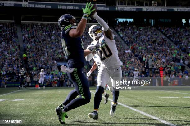 Nick Vannett of the Seattle Seahawks makes a catch past Desmond King II of the Los Angeles Chargers in the first quarter against the Los Angeles...