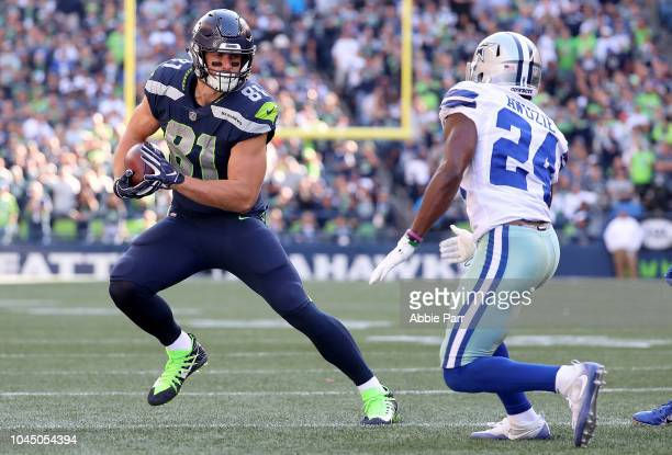 Nick Vannett of the Seattle Seahawks works against Chidobe Awuzie of the Dallas Cowboys in the fourth quarter during their game at CenturyLink Field...