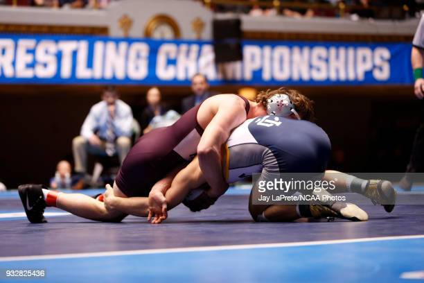Nick Velez of Ithaca wrestles Lucas Jeske of Augsburg in the 165 weight class during the Division III Men's Wrestling Championship held at the...